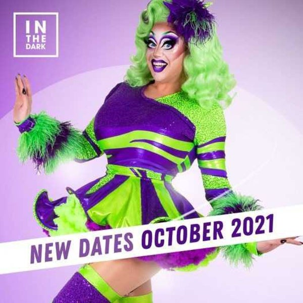 Photo of drag queen dressed in purple and green dress. Text banner overlay reads: New Dates October 2021